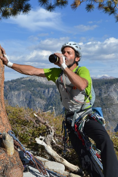 Steve chugs a Sierra Nevada with one hand on El Cap Tree.