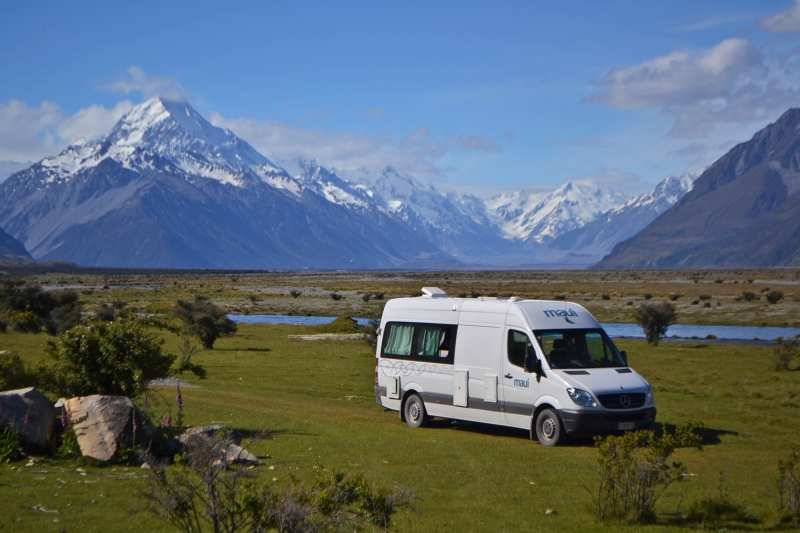 "Paisley and I ""dirtbagging"" it in our full-size Sprinter van below Mt. Cook, New Zealand. This was expensive and we decided we wouldn't use a vehicle quite so large for a U.S. roadtrip. (or at least we would organize it very differently)"